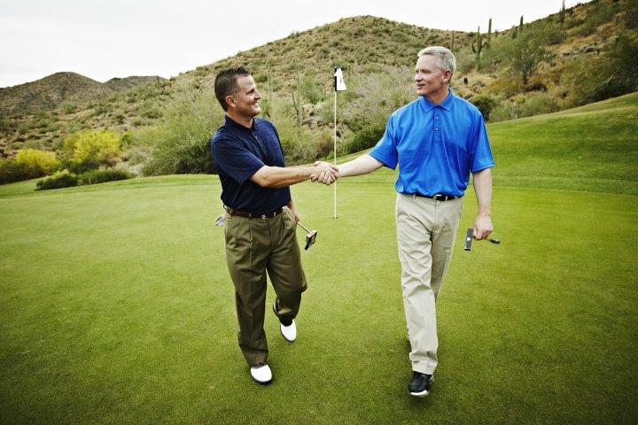 golfers hand shaking